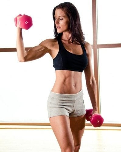 slender woman working out with dumbells